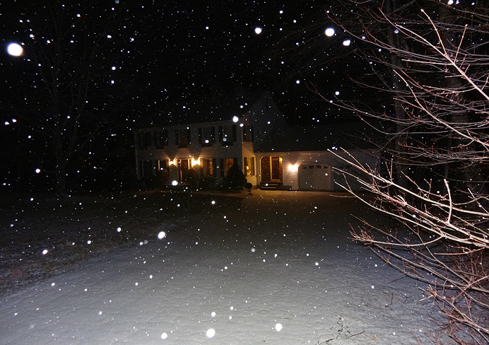 House at night in snow