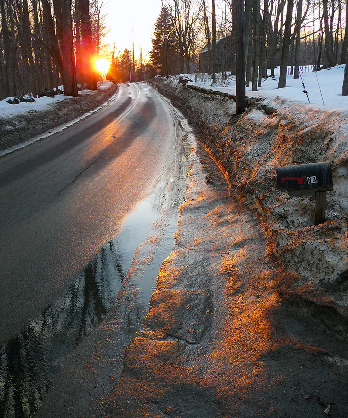 Sunset on thawing street