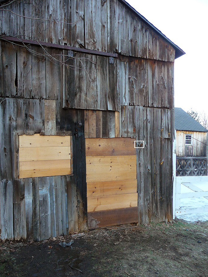 Boarded up barn