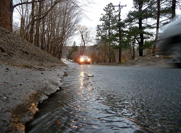 Water draining along road