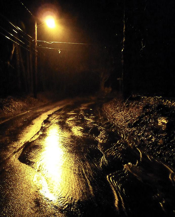 Wet street corner at night