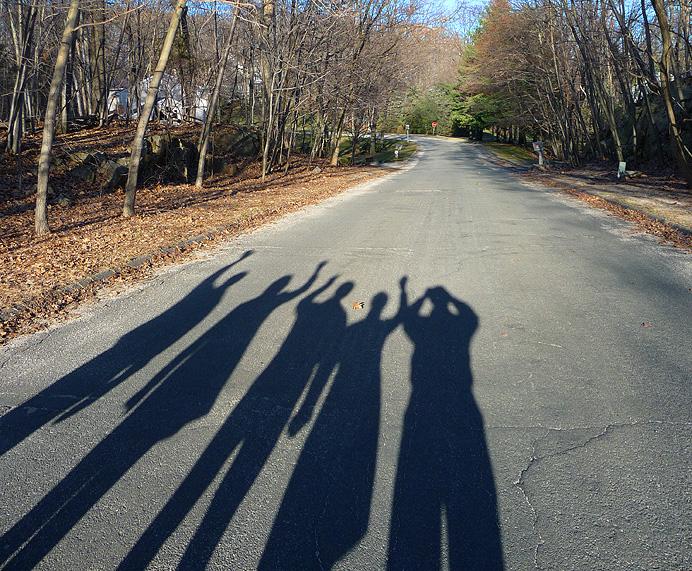 Shadows of people waving