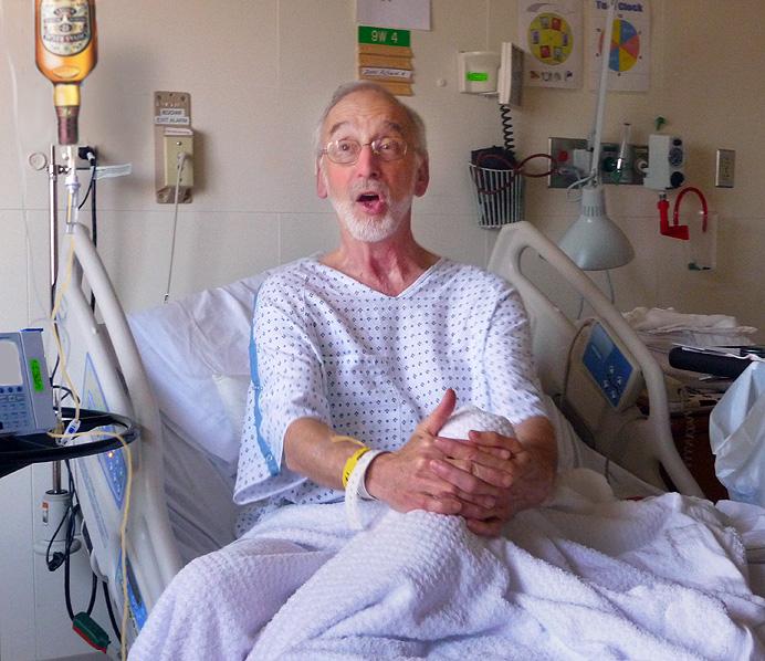 Man singing on hospital bed