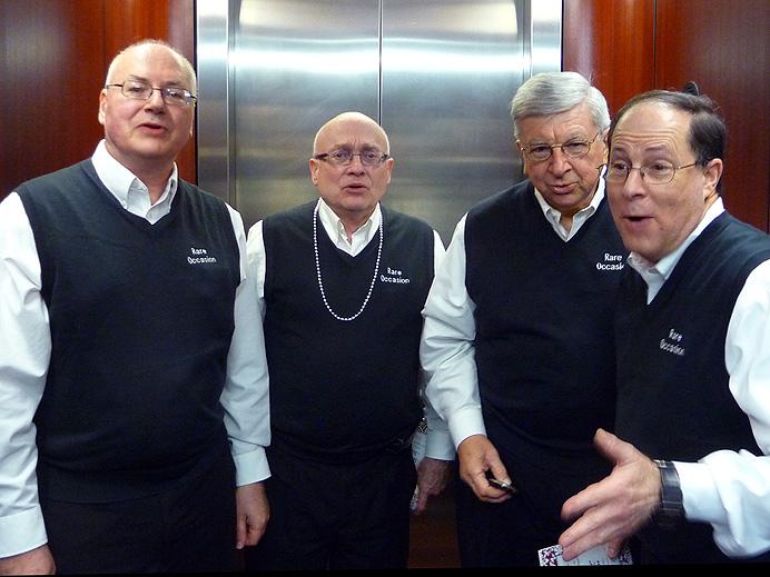 Barbershop quartet singing in an elevator