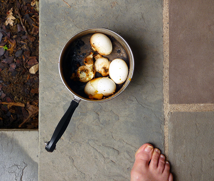 Burnt eggs in a saucepan