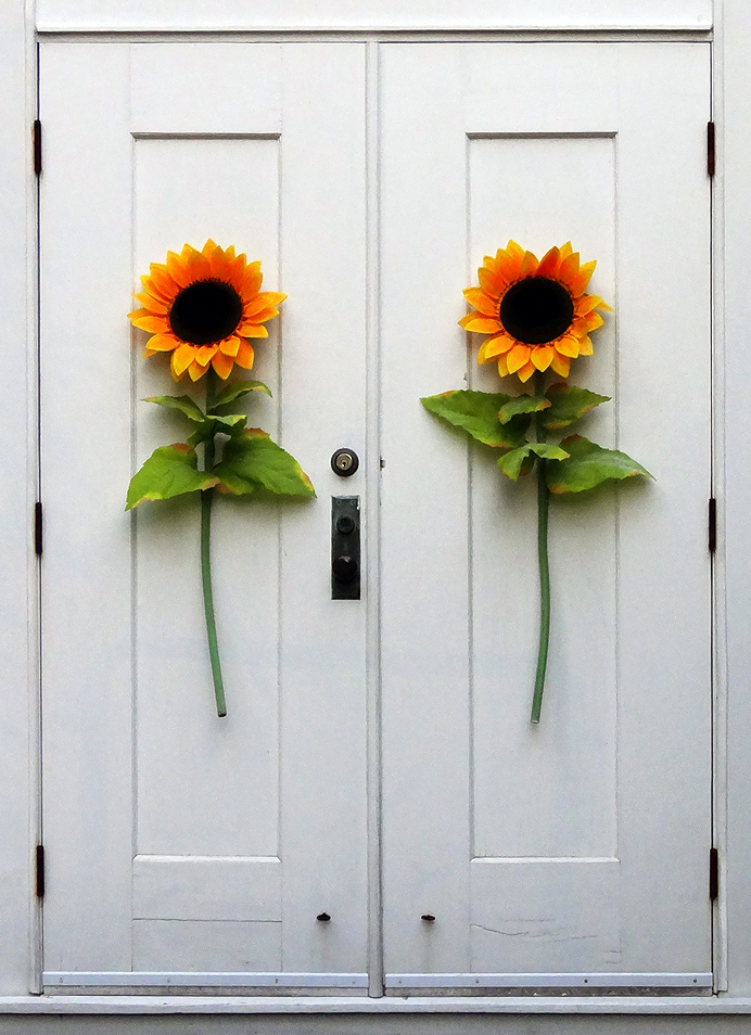 Church door with sunflowers