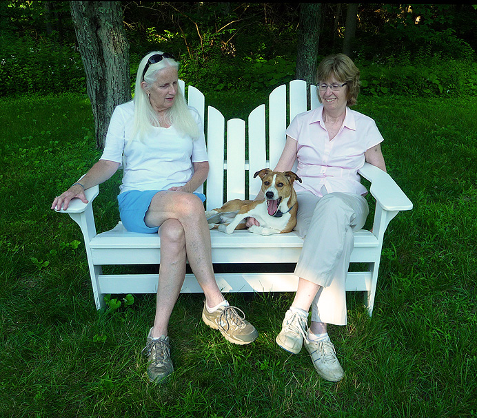 Women and dog on Adirondack chair