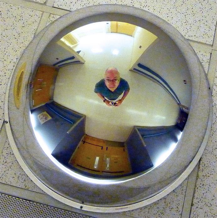 Man in overhead mirror