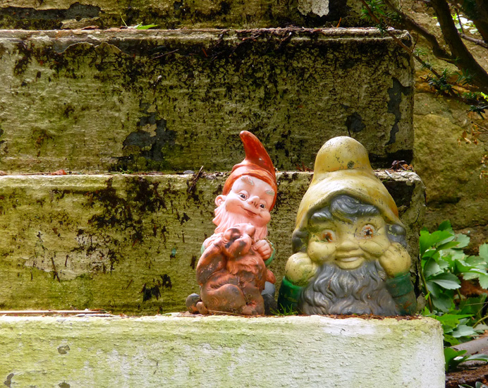 Decrepit gnomes on front stoup