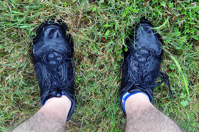 Man's feet in running shoes