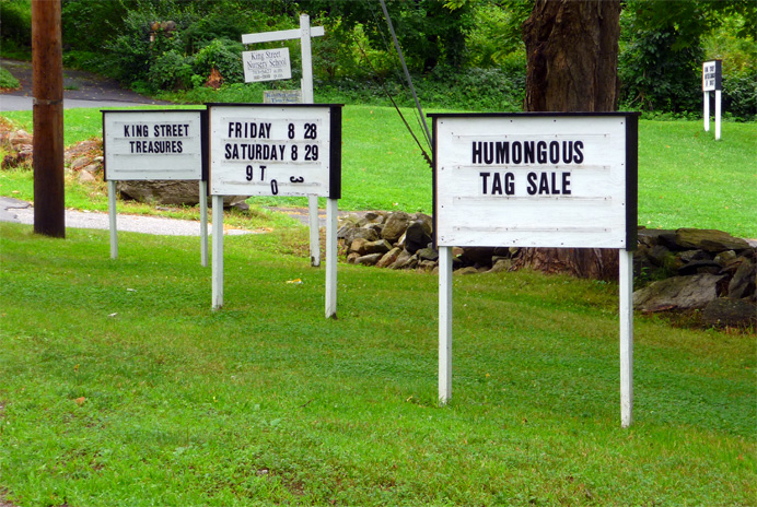 Signs advertising yard sale
