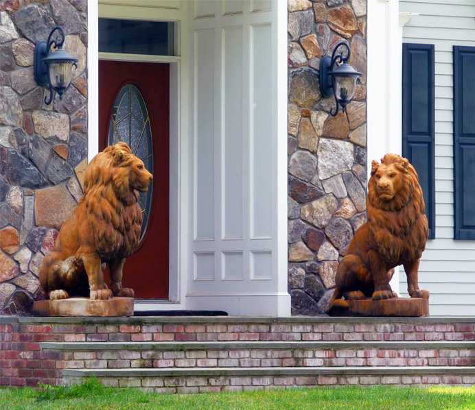 Statues of two lions on porch