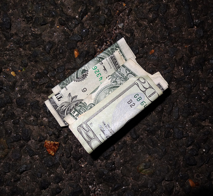 Money lying on pavement