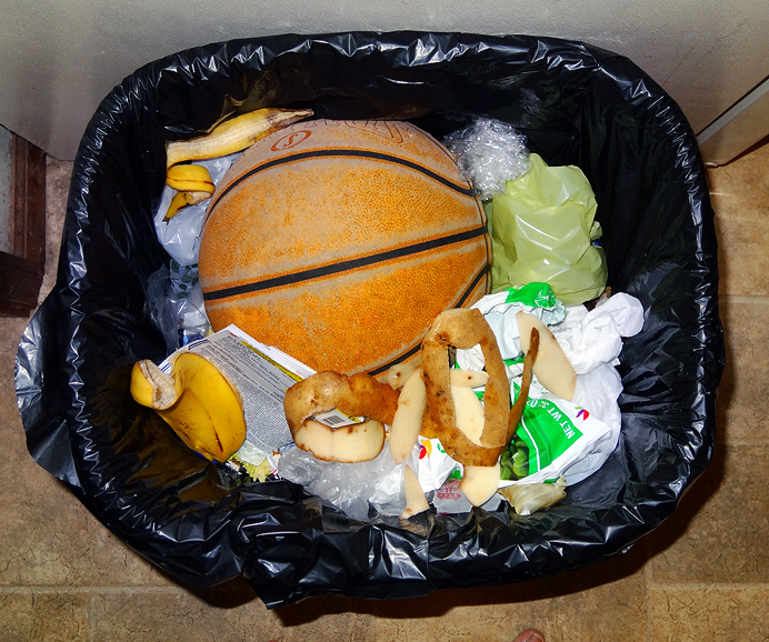 Basketball in trashcan