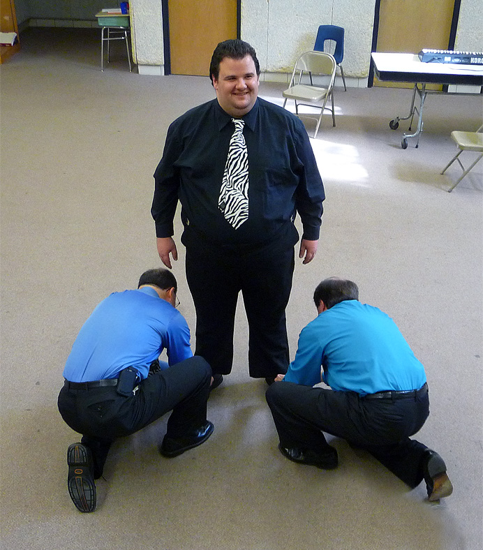 Man getting his shoes tied