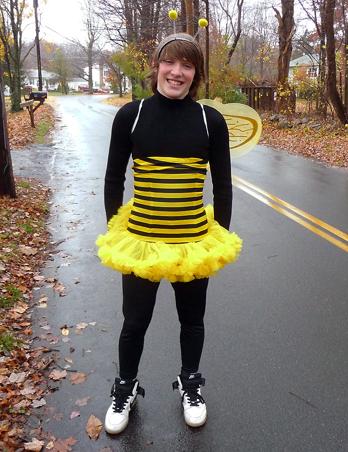 Teen in bee costume