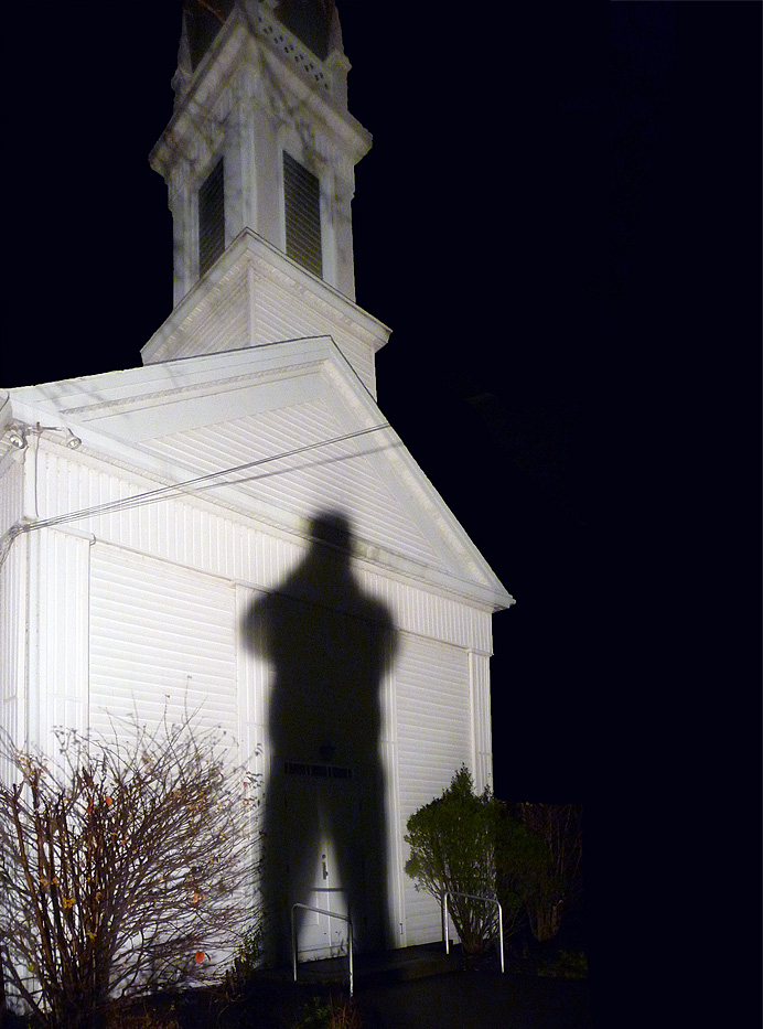 Man's shadow on church front
