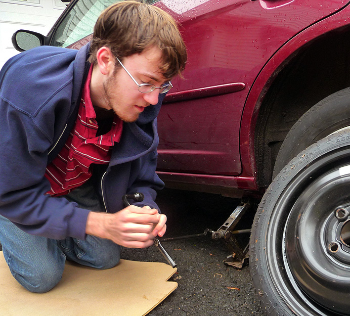 Teen-ager changing a tire