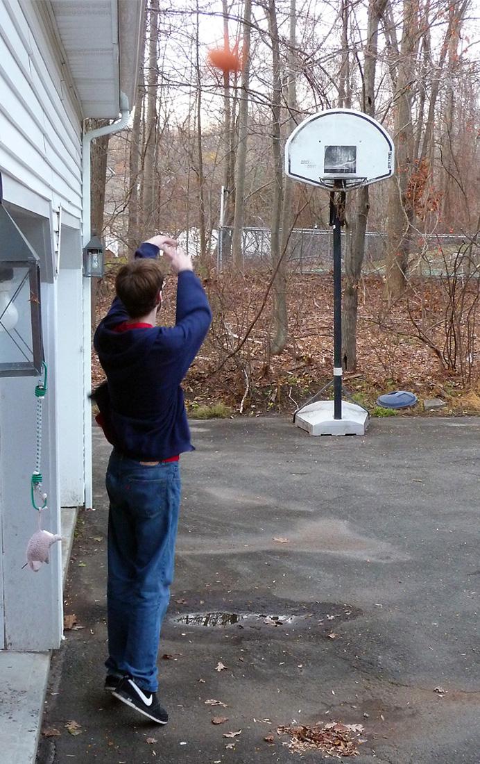 Young man shooting baskets