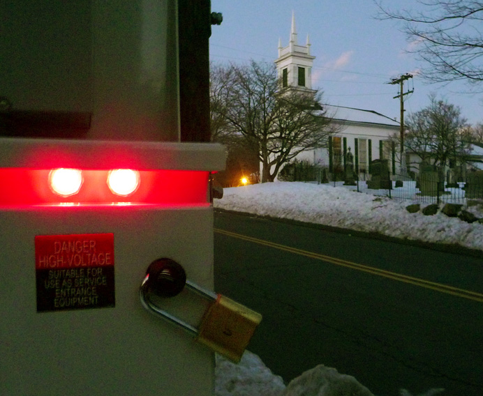 Electric box with church in background