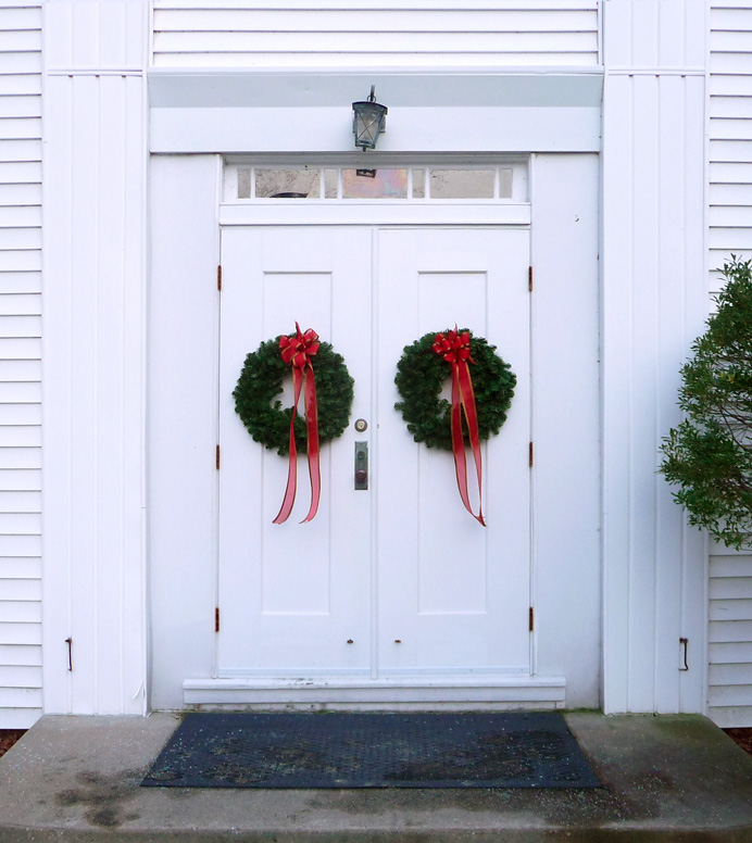 Church door with Christmas wreaths