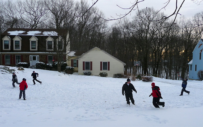 Children playing football in the snow